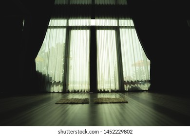 light of the door pass a curtain in the home with silhouette in home
