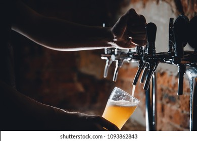 Light Draft cold beer pour in glass from crane in pub. - Shutterstock ID 1093862843