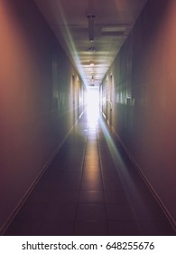 Light at the end of corridor, warm light