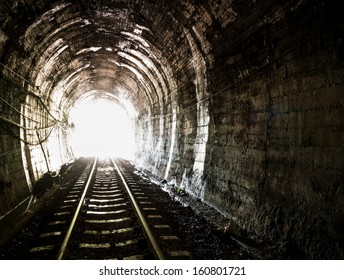 Light at the end of railroad tunnel. Khuntan tunnel ,Thailand.