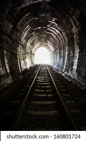 Light at the end of railroad tunnel. Khuntan tunnel