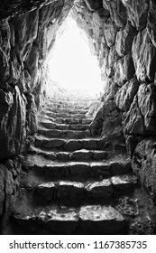 light at the end of stone tunnel (black&white)