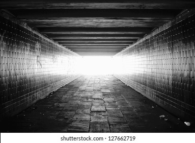 Light at the end of tunnel black and white.Grain added