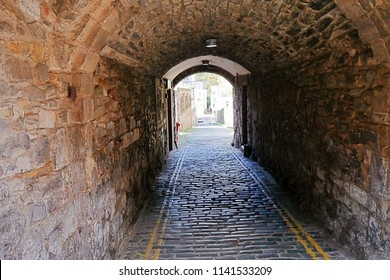 Light at the end of the tunnel. Tunnel at Royal Mile Edinburgh, Scotland Stone built, Rocks