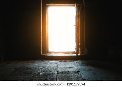 Light entering through open door to a dark room