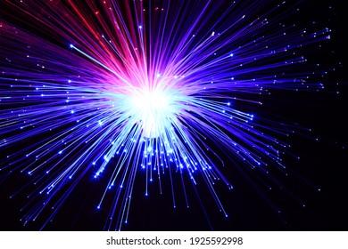 Light explosion effect background. Flying lights purple, red, blue. Big bang effect.
