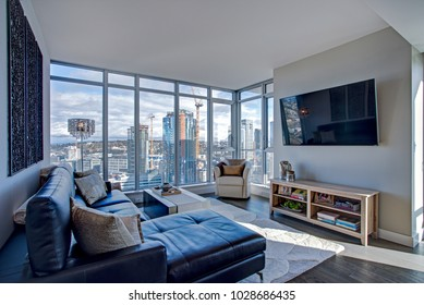 Light filled floor plan boasts a modern family room design with panoramic view of downtown Seattle.