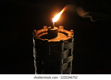Light the fire on wooden torch in the darkness environment