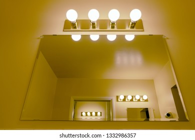Light fixtures and mirrors
