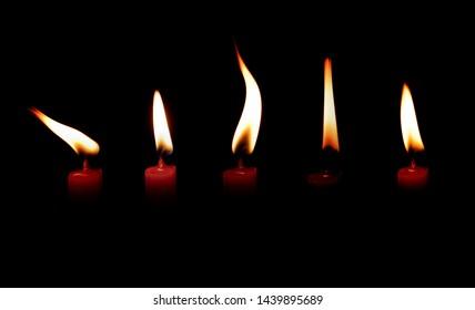 light flame candle burning brightly on black background