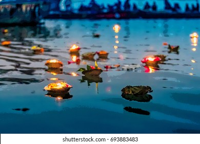 Light and flower offerings at sunset on the river Ganges.