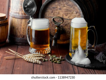Light foam beer in a glass on an old background