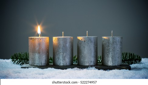 Light four advents candles with matches.