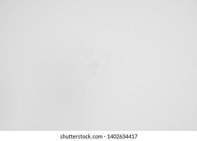 Light gray concrete wall with various structures and light soiling. Plastered wall as background and art object in industrial design to design media and more.