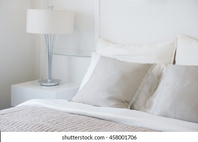 Light gray pillow setting on bed in nice vibe bedroom modern interior style