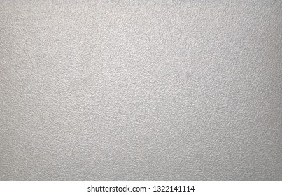 Light gray rough metallic surface. Background. Texture. Close-up.