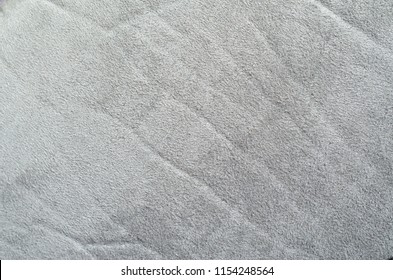 Light Gray Suede Fabric Texture. Crumpled Suede Cloth Texture Background