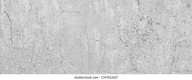 Light gray weathered stone wall with cracks. Concrete wall background texture.