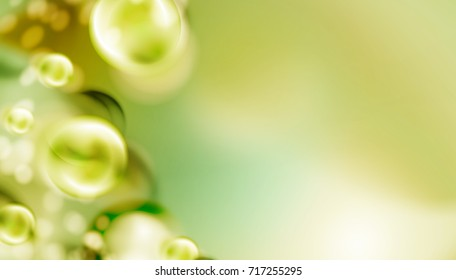 Light green abstract  background with blurred bubbles.
