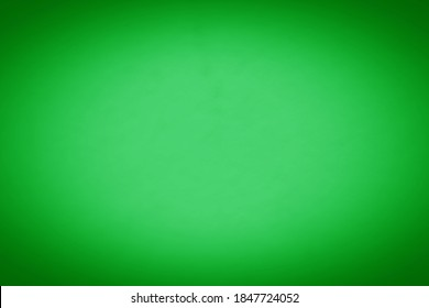 Light green background texture with dark vignette. Colorful blurred background with copy space for design.