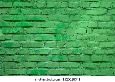 Light green block brick wall for background.