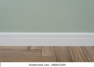 Light green matte wall, white baseboard