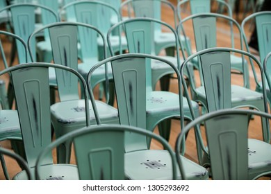 Light green  steel  chairs. Close up