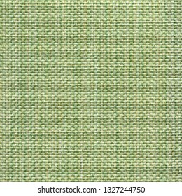 Light green textile textured background. Vintage fashion background for designers and composing collages. Luxury textured genuine fabric of high and natural quality.