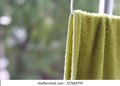 Light green towels on the balcony.