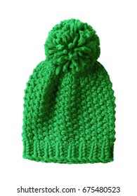 Light green woolen winter cap hat with a pom pom pompon isolated on white