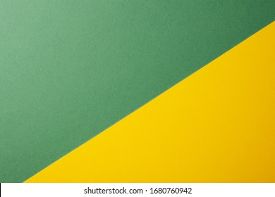 Light green and yellow color of paper background, texture, copy space, diagonal.