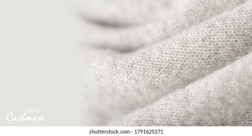 Light grey luxury natural cashmere texture. Blurred background with copy space
