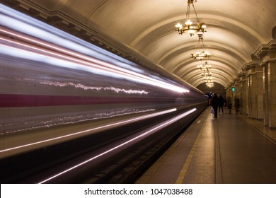 Light from the headlights of the train in the subway.