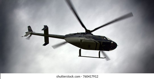 Light helicopters, private helicopter. Helicopter for transportation of individuals, medical helicopter, police helicopter on background of cloudy sky