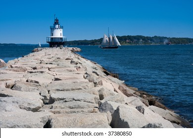 A light house at the end of a jetty in South Portland, Maine