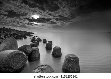 light house on a breakwater at Chendering Beach, located in Terengganu, Malaysia. long exposure photography,Soft focus effect.black and white photography