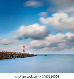 light house on a breakwater at Chendering Beach, located in Terengganu, Malaysia. slow shutter speed effect,