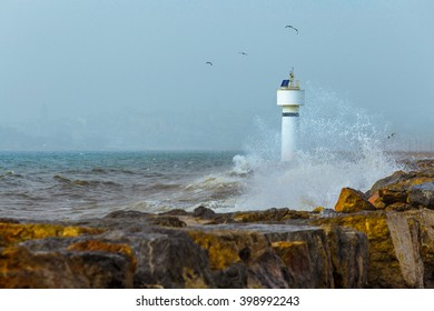 Light house in stormy day