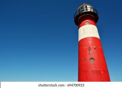 Light house tower on blue sky