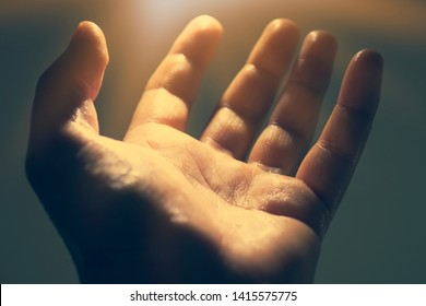 Light in human hand in the dark, miracle concept