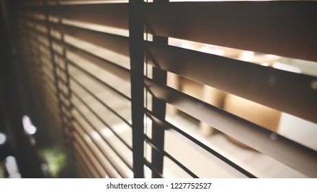 light inside bathroom and wooden window blinds, sunshine and shadow on window blind and Granite tile wall, decorative interior home concept