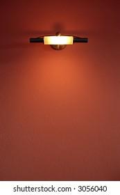 Light lamp over a orange wall