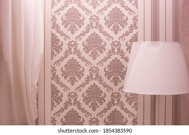 light lamp shade on a beige wallpaper background. Nice interior and decor of the room.
