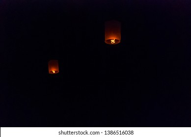 Light up lanterns flying to the sky at night during Loy Krathong festival in Chiang Mai, Thailand