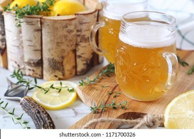 Light lemon sour beer and citrus, two beer mug