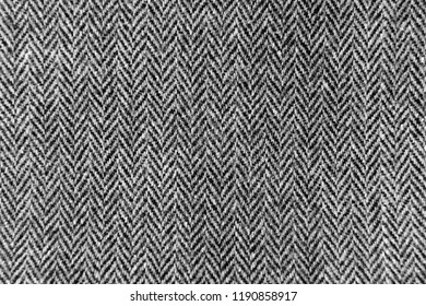 light linen fabric in a fine and wide black strip used for tablecloths, drapes. light coarse coarse linen cloth in a wide black strip used for tablecloths, bedspreads and carpets
