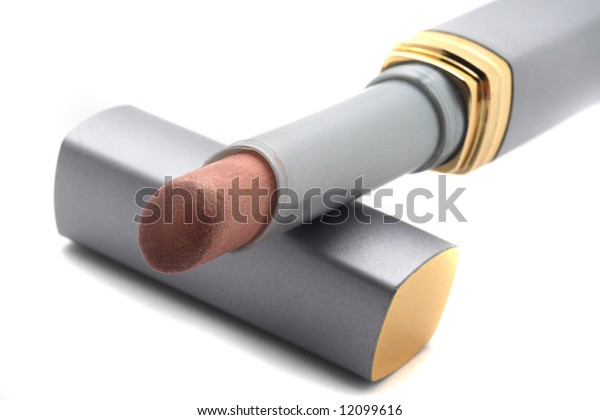 Light lipstick in grey tube on white background