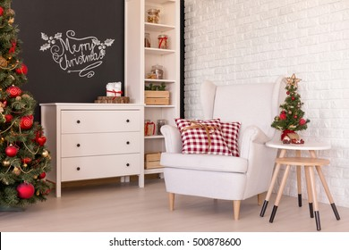 Light living room with traditional Christmas decorations