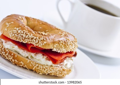 Light meal of smoked salmon bagel and coffee