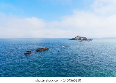 A light mist begins to slowly creep over the sea towards Fort National on its small island near St Malo.